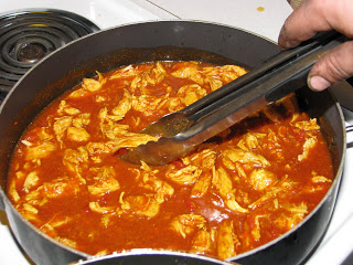 Cooking shredded chicken for Chicken and Rice Burritos