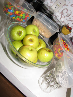 Green apples in a bowl with candies