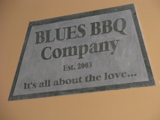 Blue BBQ sign inside