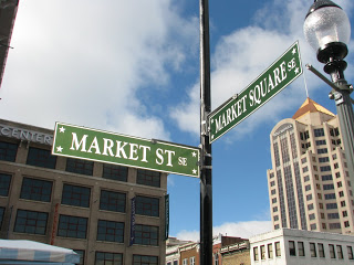 Where Blues BBQ Company is located - Street signs for Market St. and Market Square