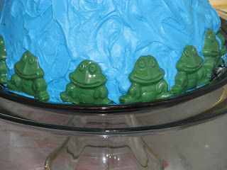 Chocolate frogs on the bottom of the Princess and the Frog Birthday Cake