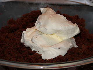 Adding cream cheese to crumbled cake