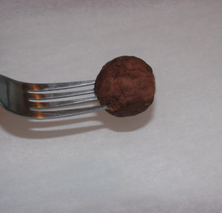 Cake Truffle on fork ready to be dipped into chocolate