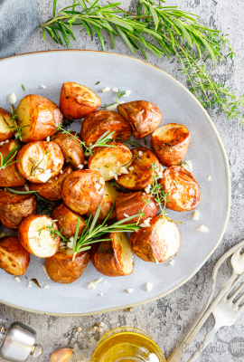This easy Garlic Rosemary Potatoes side dish is ready in under an hour! It's great for Thanksgiving, Christmas or just as a side for a fabulous dinner any time of year!