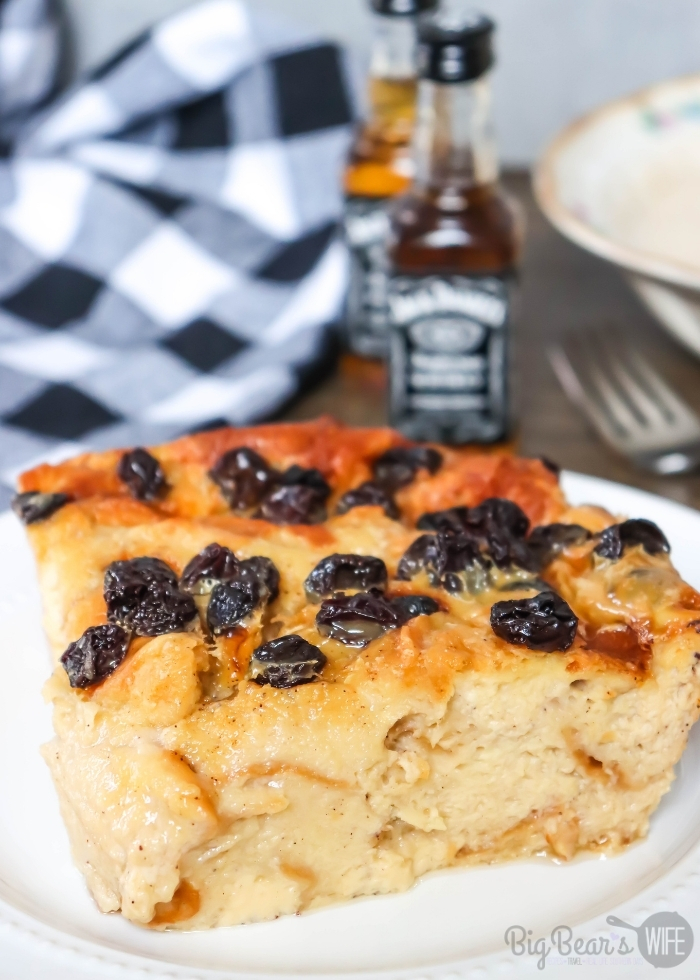 Slice of Jack Daniels Bread Pudding with raisins on a white plate