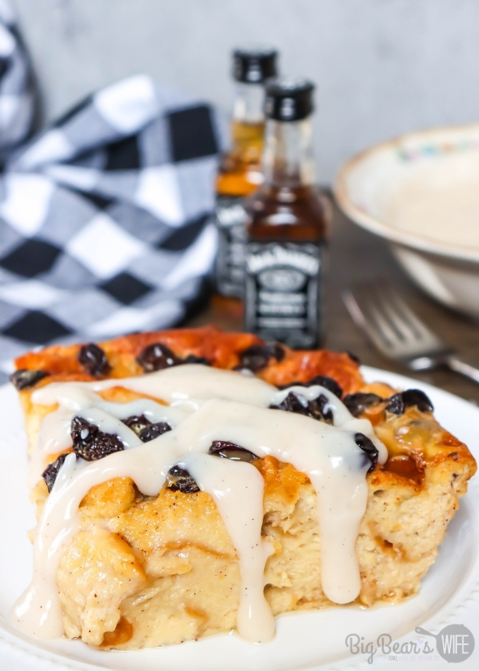 Slice of Jack Daniels Bread Pudding with raisins on a white plate (1)