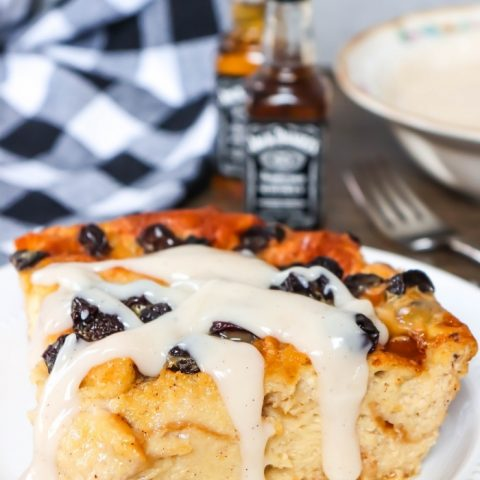 Slice of Jack Daniels Bread Pudding with raisins on a white plate (2)