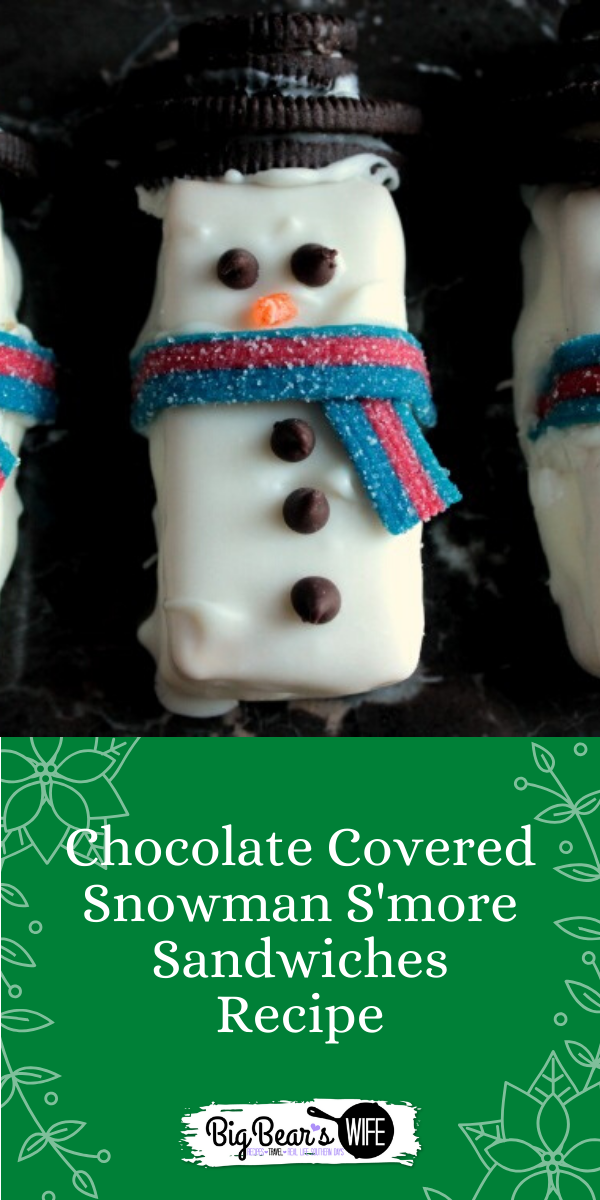 Chocolate Covered Snowman S'more Sandwiches - Graham Crackers, Marshmallow, Chocolate and Candies make up these Chocolate Covered Snowman S'more Sandwiches! Top them with Oreo hats and candy scarfs and serve them at your Holiday Party! via @bigbearswife