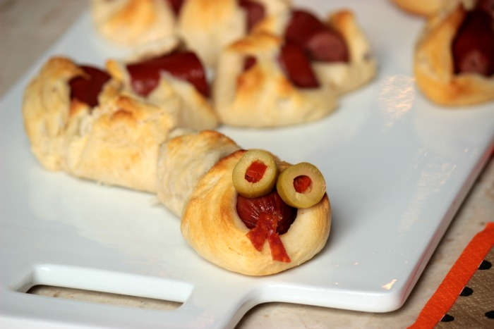 Rattlesnake Bite Hot Dog Appetizers - Easy to make and easy to eat! Rattlesnake Bite Hot Dog Appetizers need to be front and center at your Halloween Party this year!