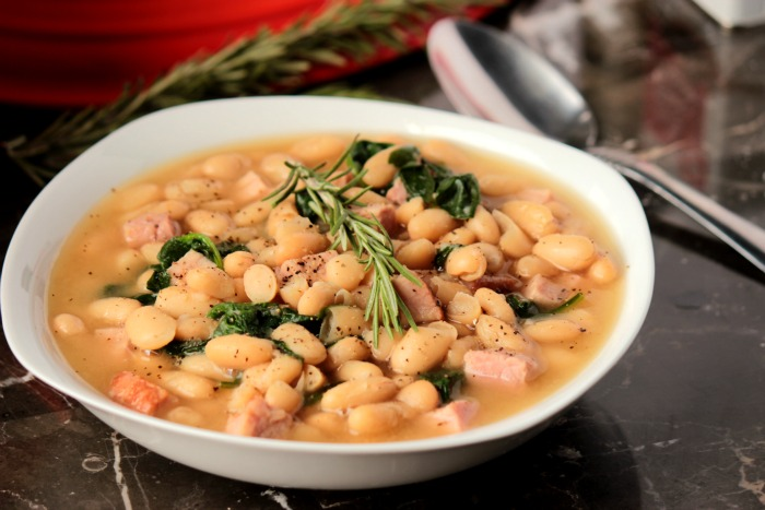 This Tuscan White Bean Soup with Ham is packed full of Cannellini white beans and ham! It's an easy soup that's ready in under 45 minutes.