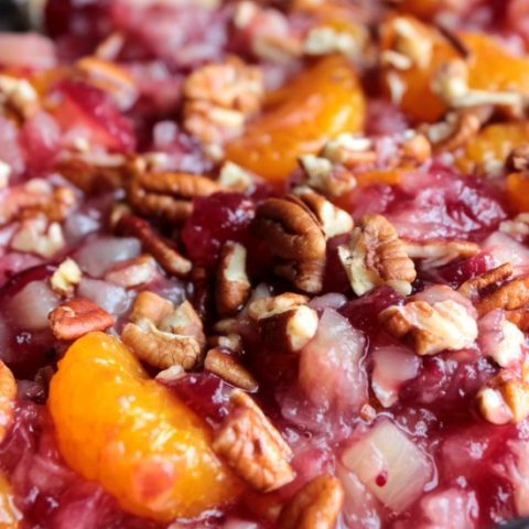1 can (14 ounces) whole-berry cranberry sauce 1 can (11 ounces) mandarin oranges, well drained 1 can (8 ounces) crushed pineapple, well drained 1/4 cup chopped pecans, toasted