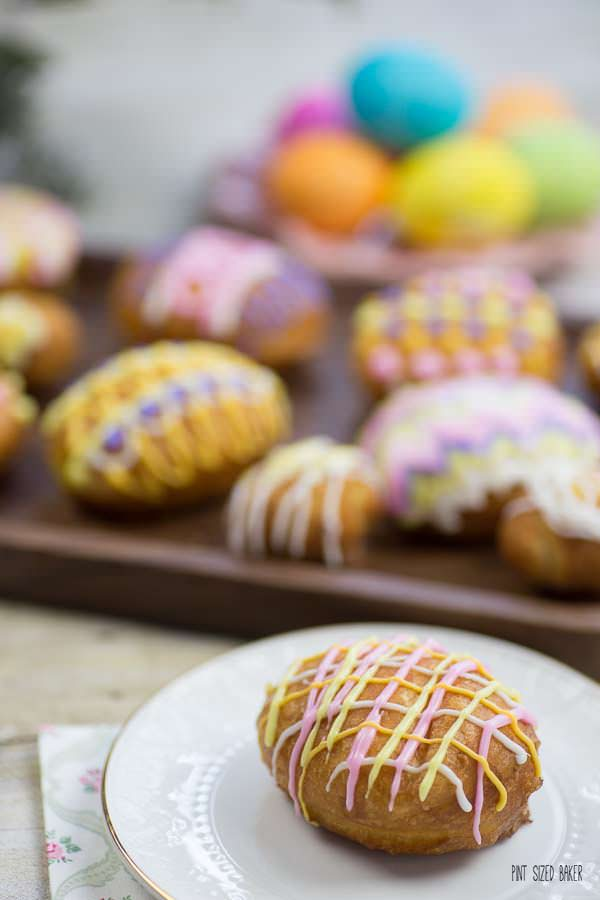 Bright spring colors decorate fun Lemon Jelly Donuts. They are perfect for an Easter celebration!