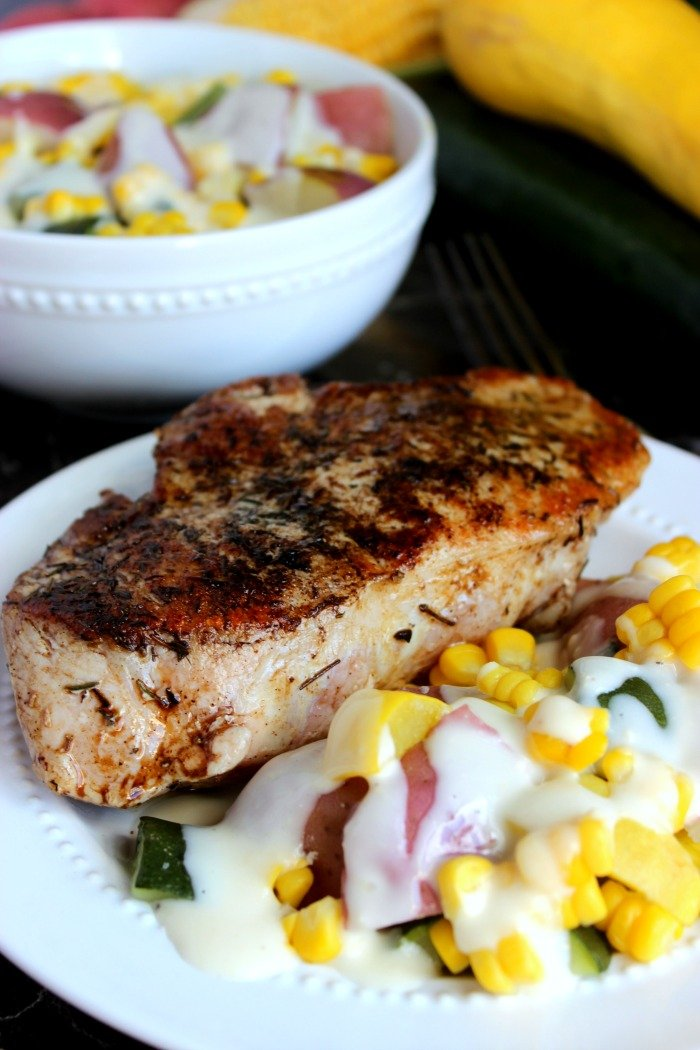 Pan-Seared Pork Chop and Garlic Parmesan Summer Vegetables with Marzetti® Veggie Drizzle™ finishing sauces