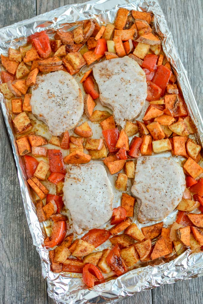These easy Sheet Pan Pork Chops with Sweet Potatoes and Apples take just five minutes to prep and are perfect for a healthy fall dinner.