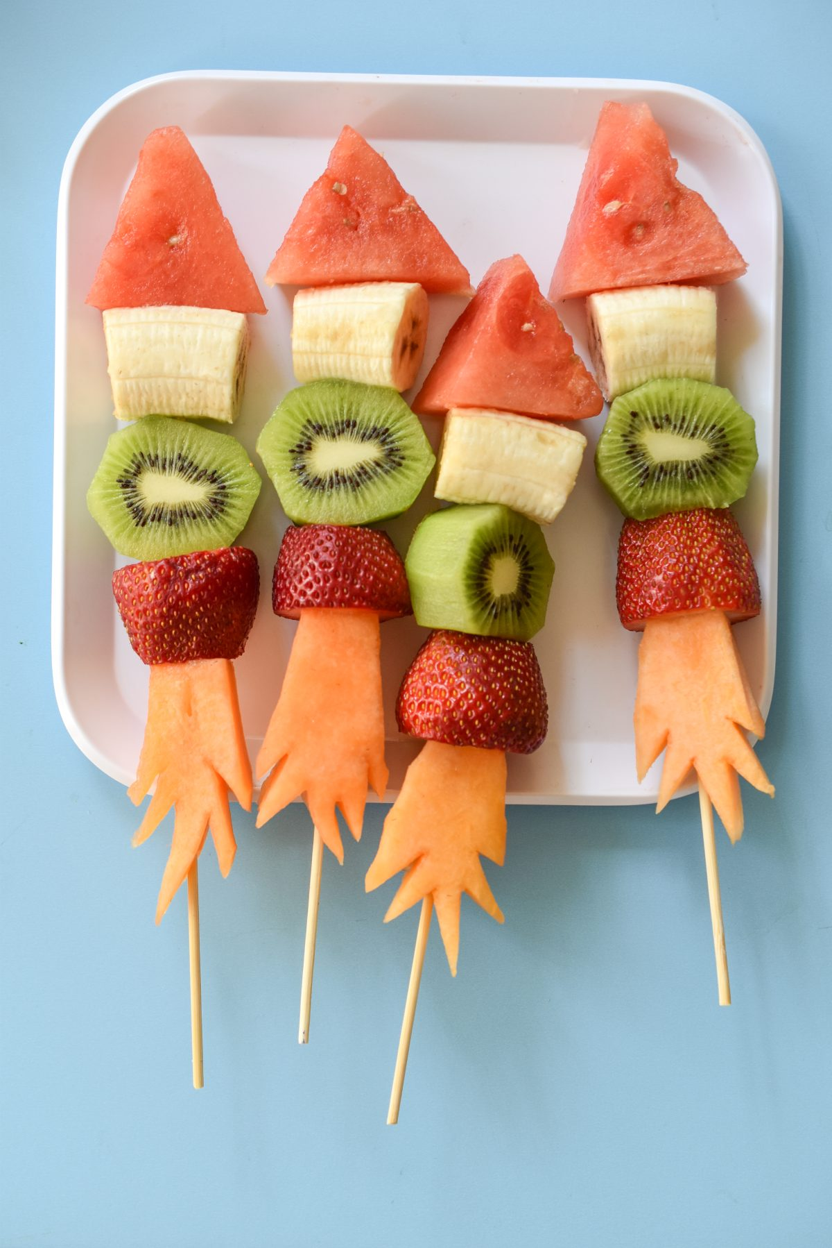 Keep your kids safe, healthy, and entertained this summer with these DIY Firecracker Fruit Kabobs!