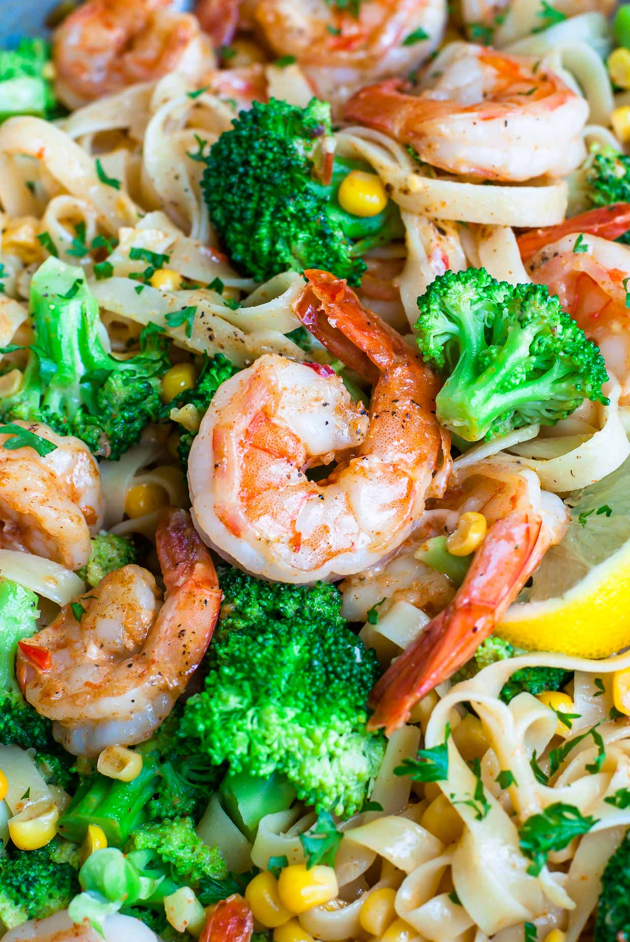Cajun Shrimp Pasta tossed in a zesty lemon cream sauce with lots of veggies: this crazy colorful pasta dish is fast and flavorful!