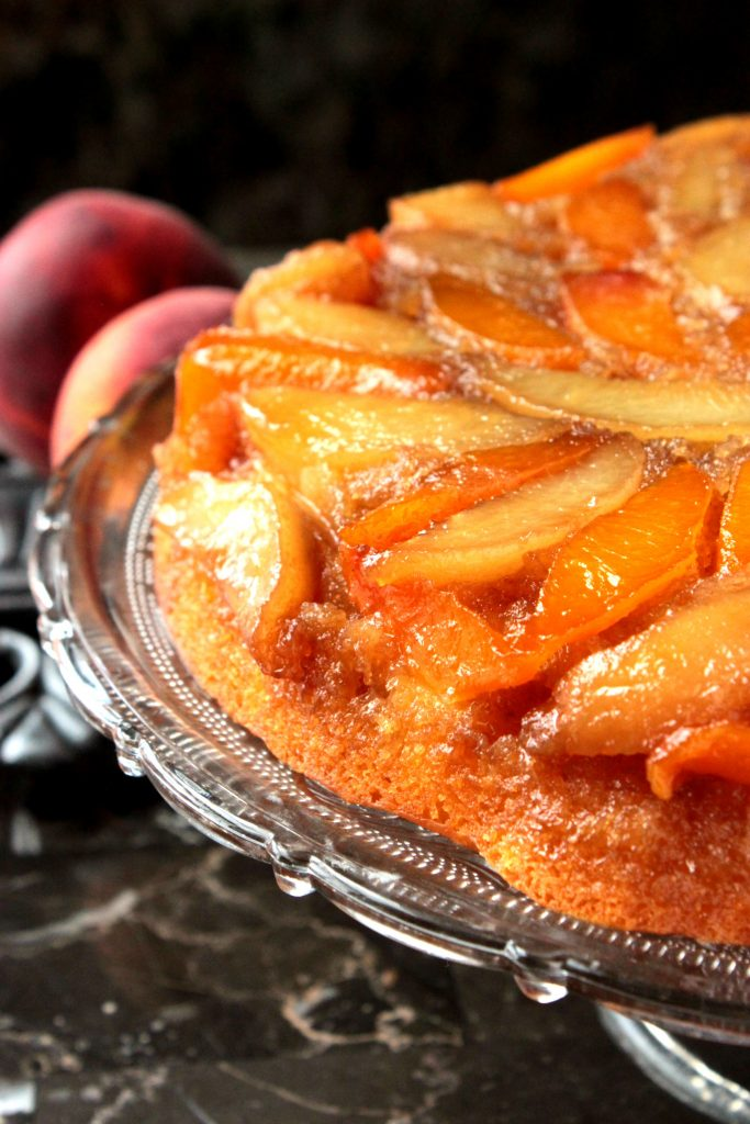 Peach Upside Down Cake - Are you a fan of pineapple upside down cake? If so, I know you're going to be peachy keen over this homemade Peach Upside Down Cake topped with brown sugar, melted butter and fresh peaches!