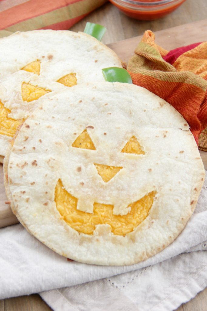 Jack-o-lantern Quesadillas - These quesadillas would be perfect to make for a quick lunch or dinner before trick-or-treating. Just serve them up with some salsa and of course, guacamole! Happy Halloween!