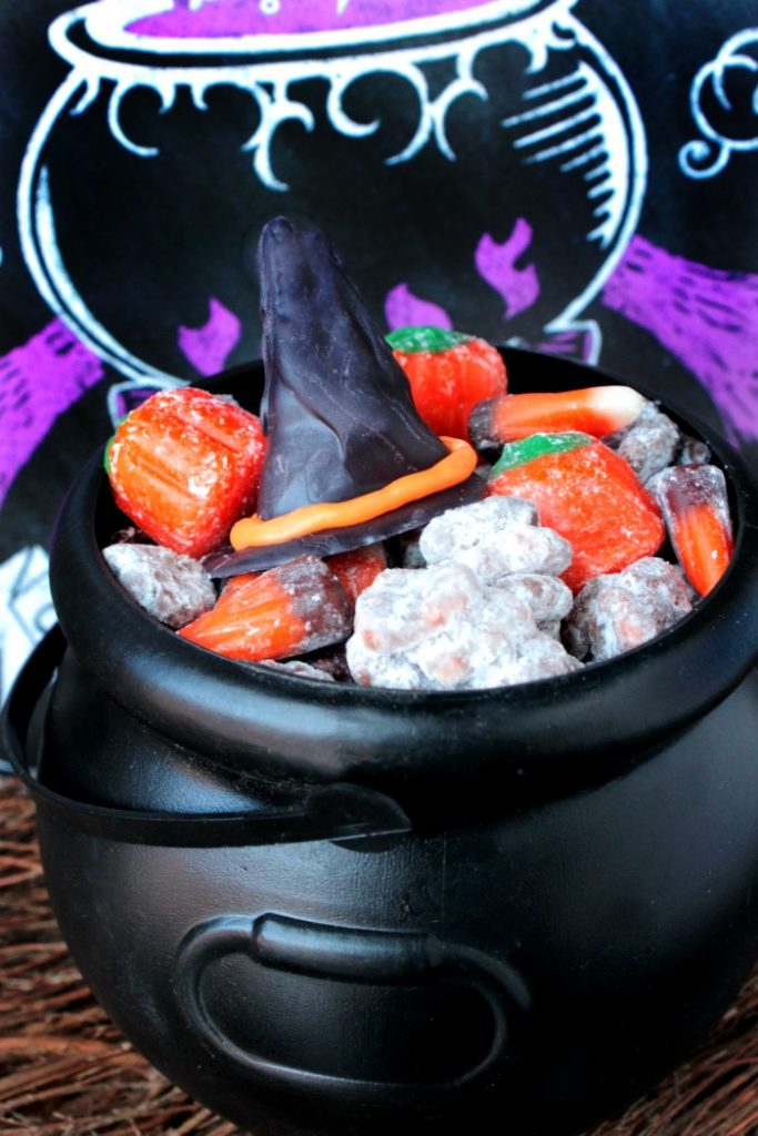 Witch Hat Puppy Chow Snack - Share this spooky snack with the Halloween witches in your life! This Witch Hat Party Mix is packed with Halloween cereal, candy and chocolate witch hats!