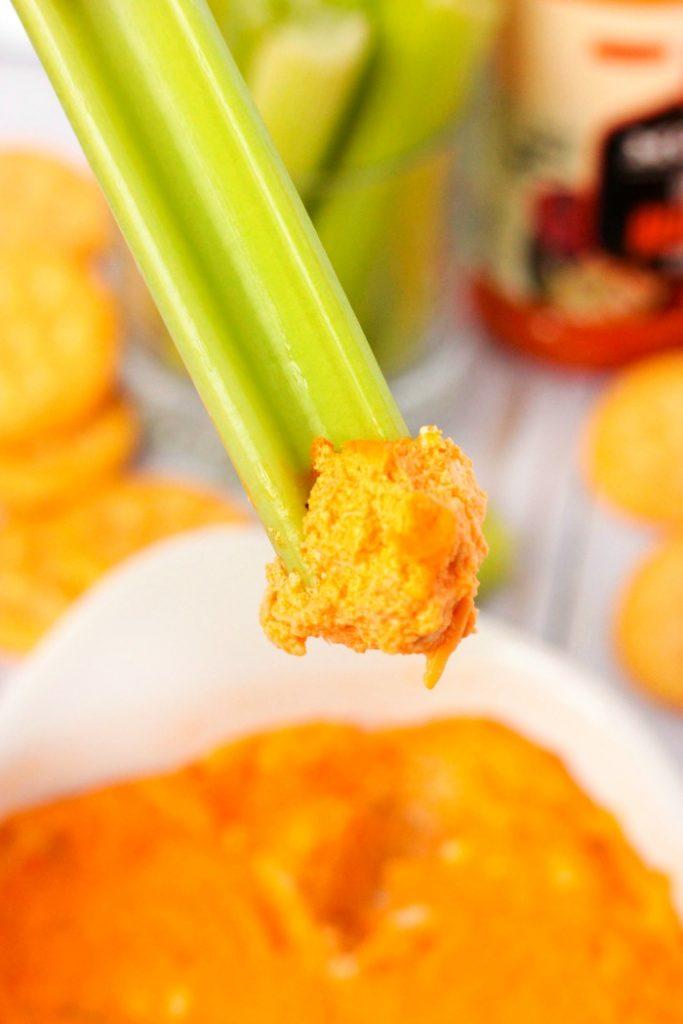 Buffalo Chicken Dip on a celery stick