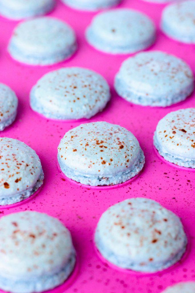 Robin Egg Macarons halves on baking mat