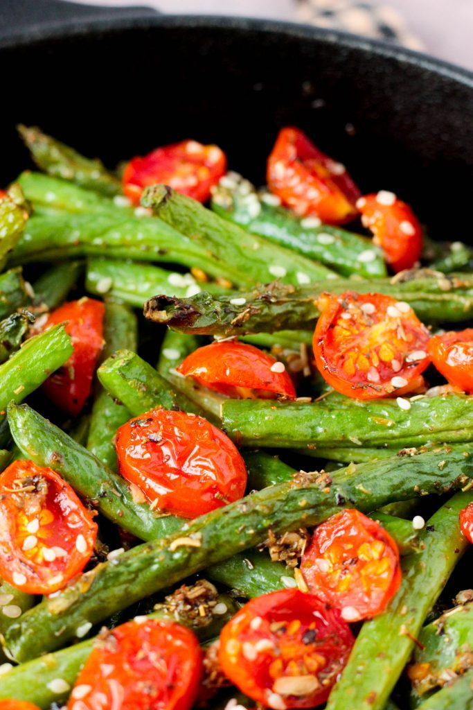 Close up of Roasted Garlic Sesame Seed Green Beans and Tomatoes