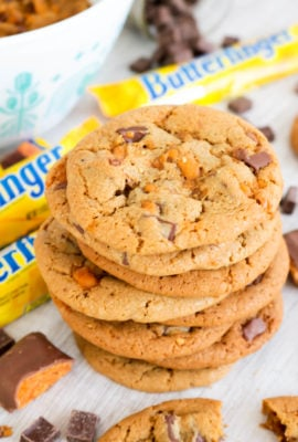 Chocolate Chunk Butterfingers Cookies - Soft and chewy cookies packed with chocolate chunks and chopped Butterfinger Candy Bars. One bite of these and you'll feel like a kid in a candy store!!