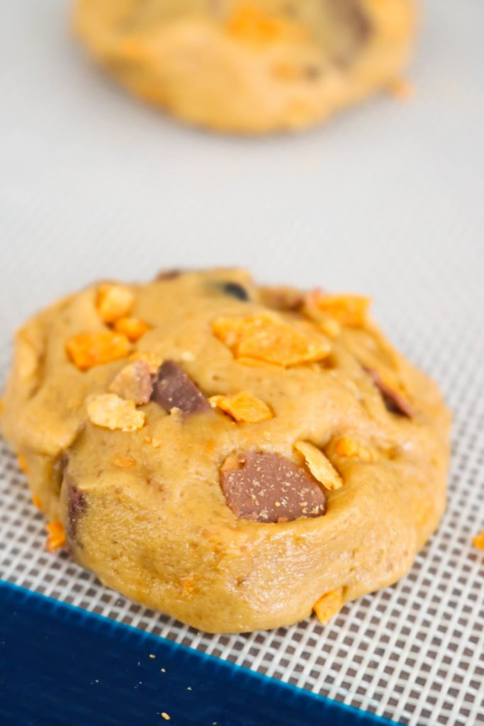 These Chocolate Chunk Butterfinger Cookies are soft and chewy cookies packed with chocolate chunks and chopped Butterfinger Candy Bars. One bite of these and you'll feel like a kid in a candy store!!