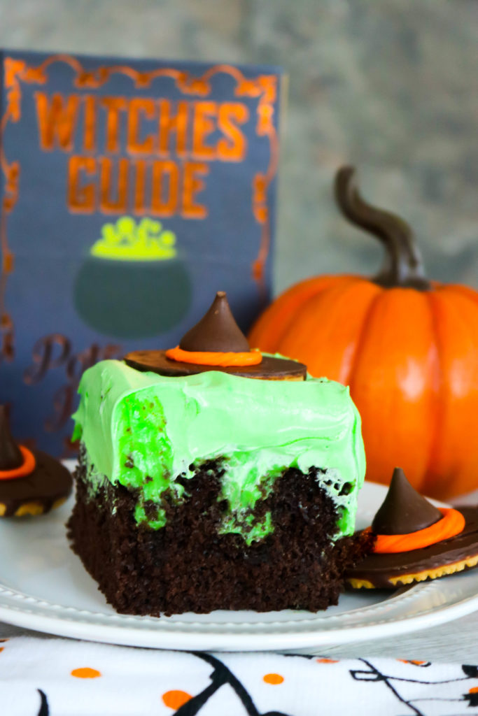 Melting Witch Poke Cake - A classic southern dessert is turned into a wickedly wonderful Halloween treat with this easy Melting Witch Poke Cake!