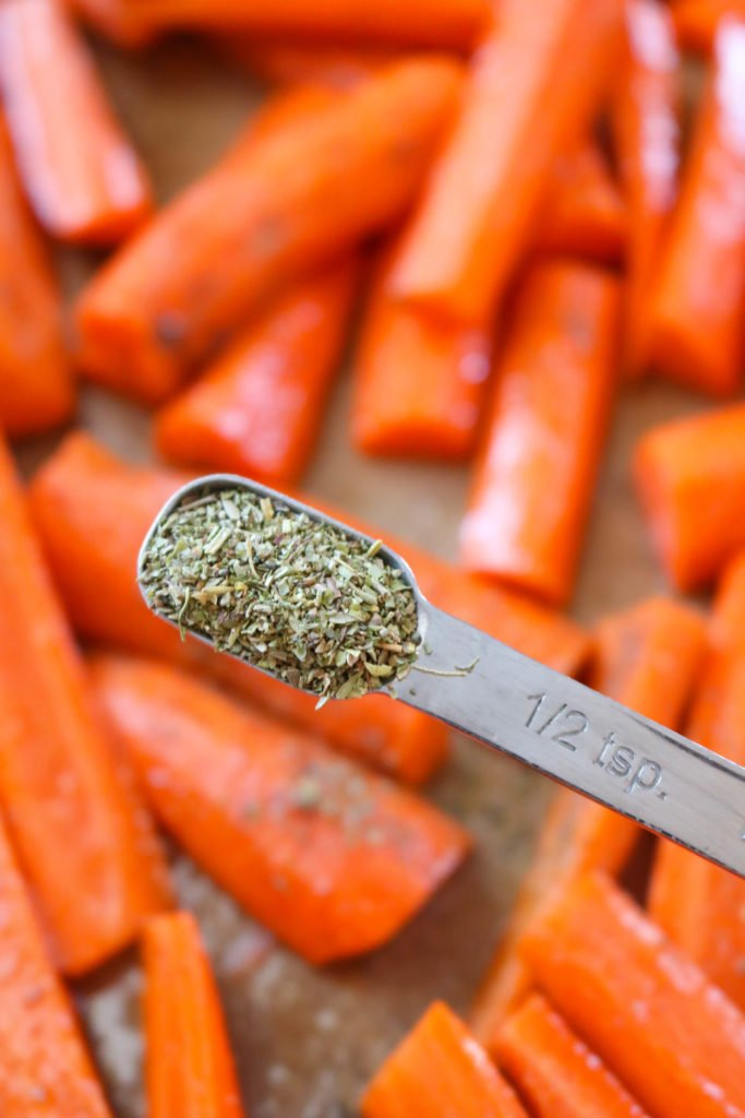 Seasoning in Teaspoon over Carrots