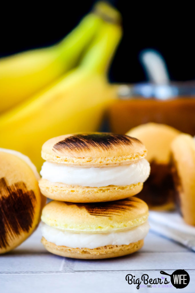 Bananas Foster Macarons - Take a culinary vacation down to good ol' New Orleans with these homemade Bananas Foster Macarons! These banana macarons are filled with a homemade banana and rum frosting and have a caramel sauce center.
