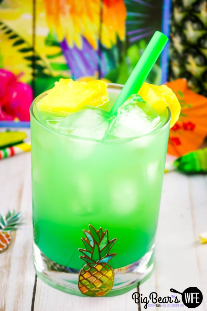 Mermaid Pineapple RumDum - This Mermaid Pineapple RumDum will make you feel like you're hanging out on the beach! It's got pineapple rum and vanilla rum mixed plus it's topped with extra pineapple! For an extra kick, soak the pineapple pieces in rum for a few days beforehand!
