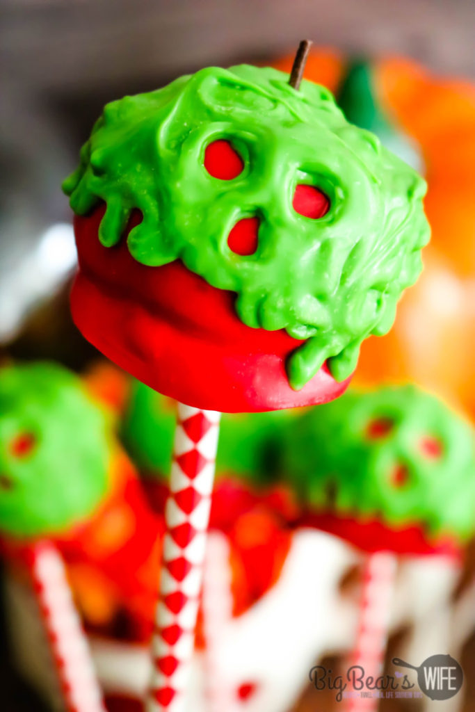 Poison Apple Cake Pops - The Evil Queen is at it again with these Poison Apple Cake Pops! Perfect for Halloween parties, easy to decorate and great for topping cupcakes or cakes!