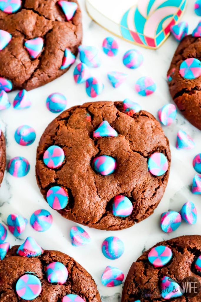 Chocolate Unicorn Cookies - If you have someone in your life that loves Unicorns you need to bake them up a batch of these Chocolate Unicorn Cookies! They're deliciousand packed with the prettiest Unicorn Pink & Blue swirled vanilla chips!