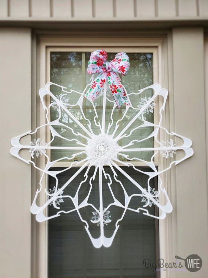 DIY Dollar Tree Snowflake Clothes Hanger Craft - These Giant Snowflakes are so easy to make and they're made using items from Dollar Tree! In this post I'll show you How to make a Snowflake from Dollar Tree Clothes Hangers under $5!