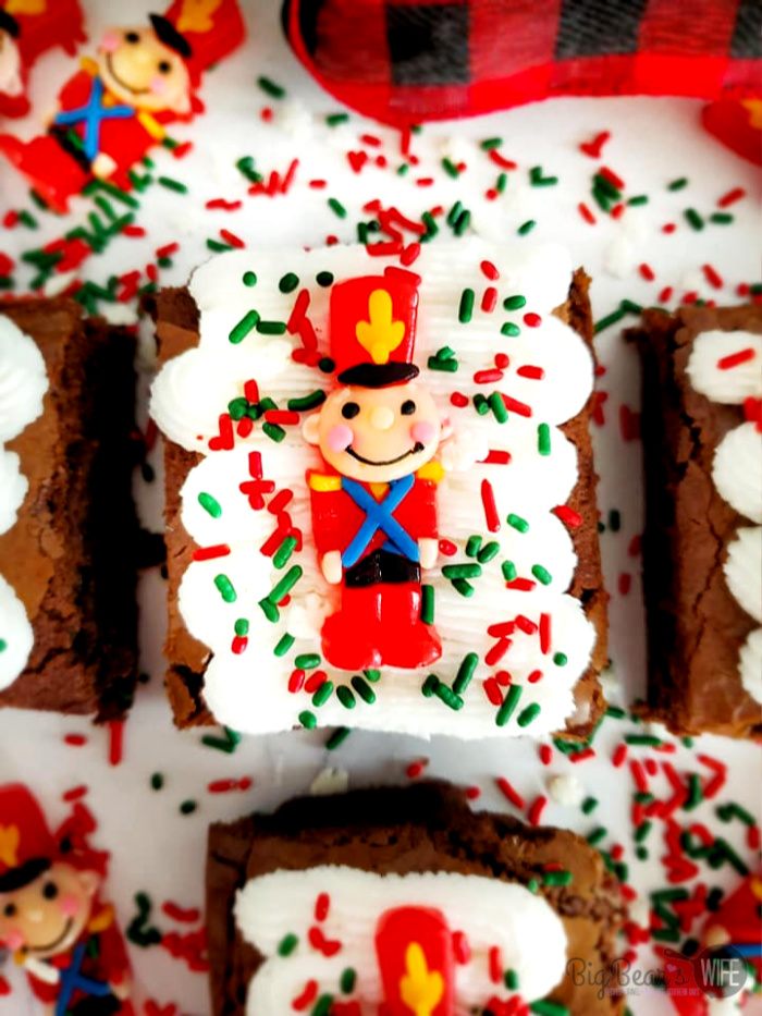 Toy Soldier Frosted Brownies - Whip up a festive batch of Holiday brownies with this recipe for Easy Toy Soldier Frosted Brownies! Kids and Adults will both have fun decorating these simple treats! So cute but so quick to toss together!