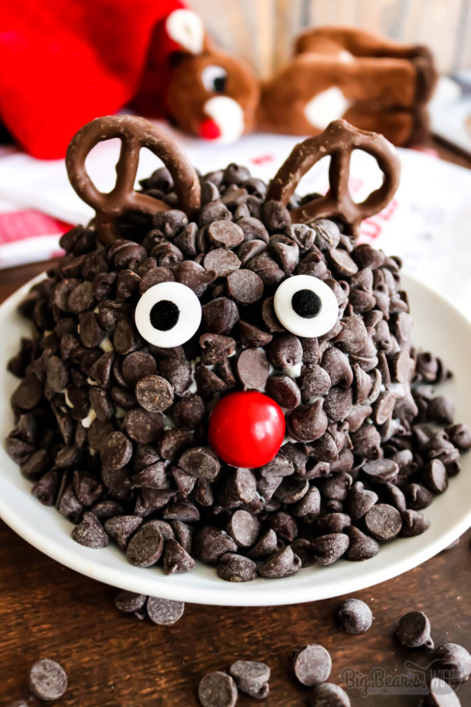 Chocolate Chip Rudolph Cheese Ball - Ready to spread some joy? Literally? This Chocolate Chip Rudolph Cheese Ball is the perfect joyful holiday dessert! A festive dessert cheeseball decorated to look like Rudolph the Red-Nosed Reindeer.