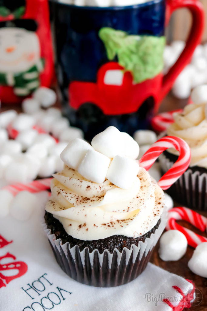Hot Chocolate Cupcakes - Whip up your favorite hot chocolate mix into these Hot Chocolate Cupcakes for the perfect winter evening treat! Top them with homemade marshmallow frosting and decorate them with mini marshmallows, mini candy canes and chocolate syrup to look like tiny mugs of hot cocoa!