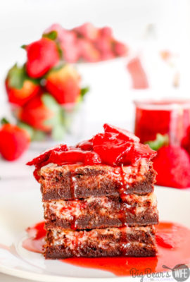 Strawberry Cream Cheese Brownies - Strawberry Cream Cheese Brownies are ooey gooey homemade brownies topped with strawberry cheesecake baked into the top of each bite. They are delicious as is just out of the oven, but to take them over the top, serve them with a Homemade Strawberry Sauce for a decadent chocolate and strawberry treat!