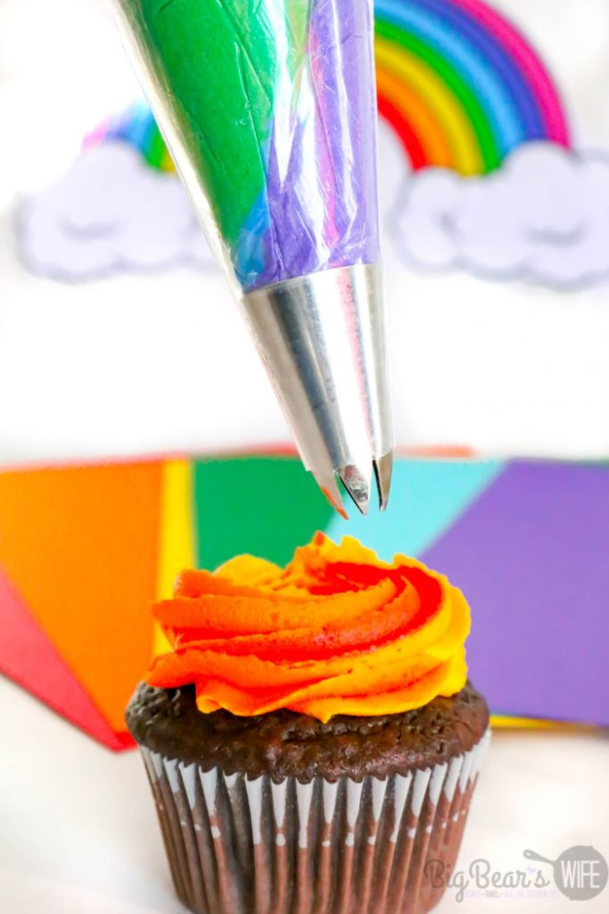 Adding Cool icing colors to Homemade Mickey Mouse Rainbow Cupcakes