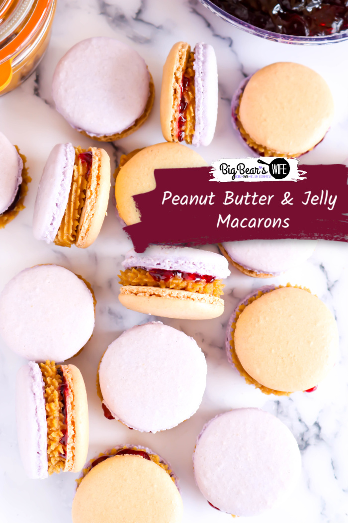 Peanut Butter & Jelly Macarons - Give your favorite sandwich a twist and turn the beloved, childhood classic, peanut butter and jelly sandwich into a homemade Peanut Butter & Jelly Macaron! These Peanut Butter & Jelly Macarons show off grape and peanut butter colored shells and are filled with a peanut butter and grape jelly filling!  via @bigbearswife