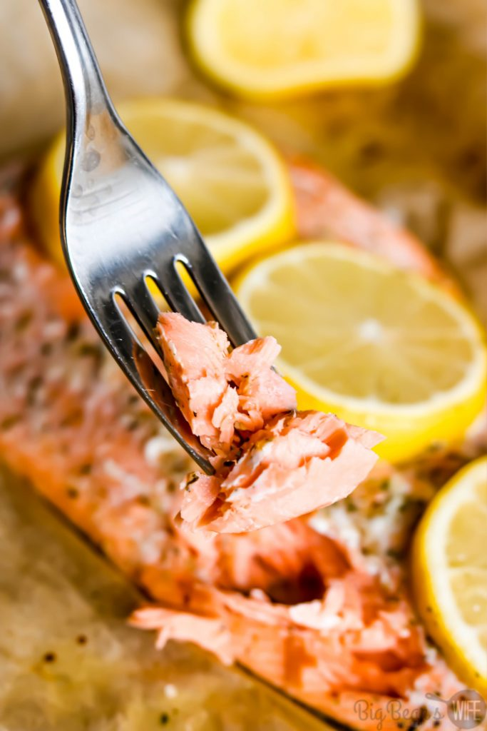 Easy Mediterranean Seasoned Parchment Paper Salmon - Dinner in under 30 minutes! This recipe for Easy Mediterranean Seasoned Parchment Paper Salmon is quick to make and easy to adapt for all kinds of different seasonings.