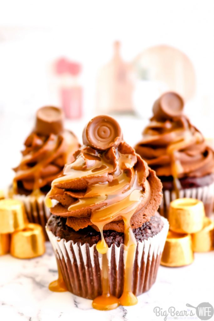 Chocolate Caramel Rolo Cupcakes - The perfect combination of chocolate and caramel come together with these homemade Chocolate Caramel Rolo Cupcakes! Homemade chocolate cupcakes are stuffed with a Rolo® chocolate and topped with fudgy chocolate frosting, drizzled caramel sauce and finished off with another Rolo® candy for the ultimate indulgent treat.