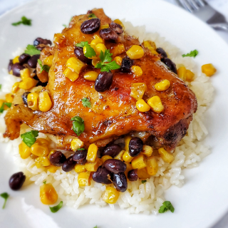 Taco Chicken Thighs with Beans and Corn - Taco Chicken Thighs with Beans and Corn is a one pot meal that's perfect on it's own or served on top of rice!