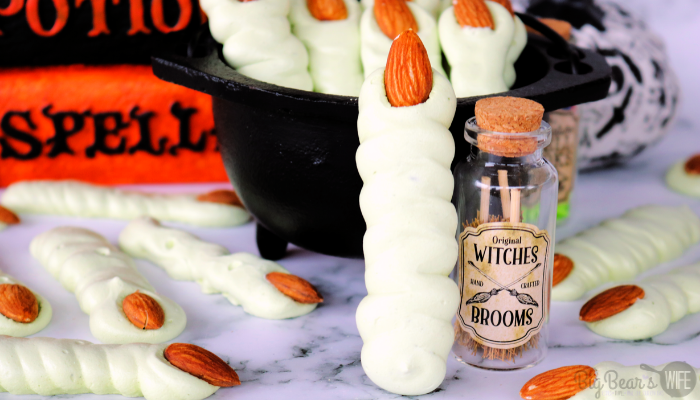 These easy Meringue Witch Finger Cookies are crispy, creepy and perfect for Halloween. These witch finger cookies are made with a meringue cookie recipe, colored green for of a bit of a classic witch look and decorated with an almond as the creepy witch nail!
