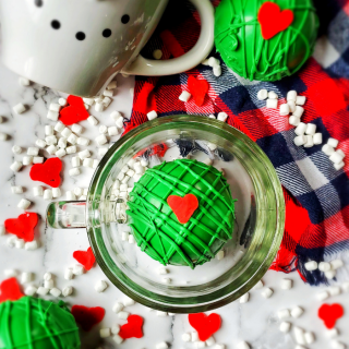 Our favorite Christmas hot coco bombs are getting a Grinchy Whoville makeover with these fun Christmas Grinch Hot Chocolate Bombs!!