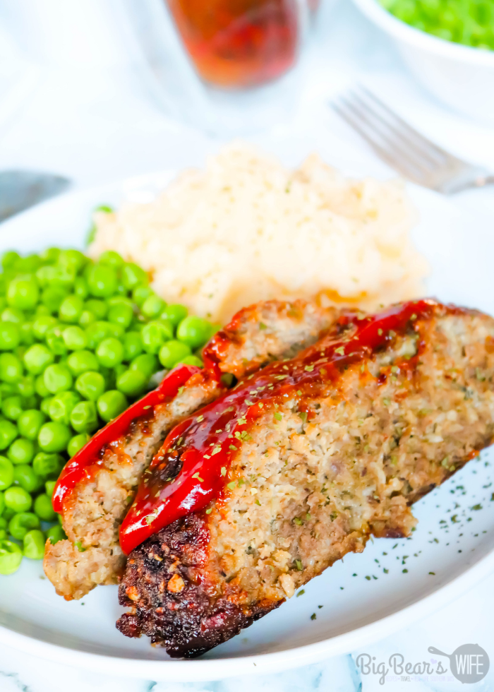 slices of Air Fryer Meatloaf with Peas and Mashed Potatoes on a while plate