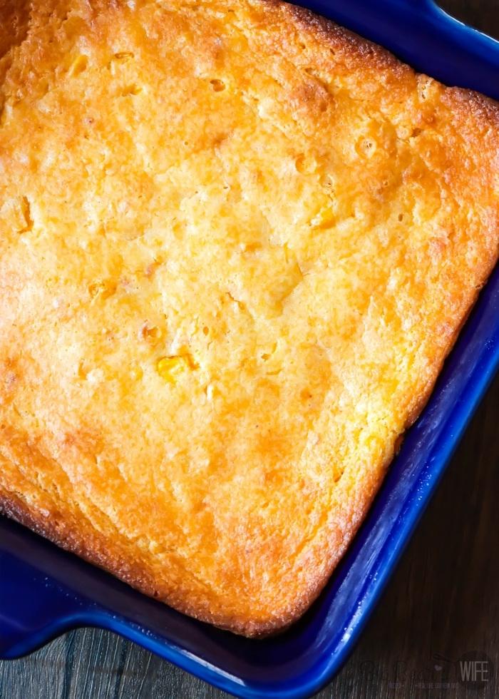 Overhead shot of Creamed Corn Cornbread _ Creamed Corn Casserole in a blue casserole dish
