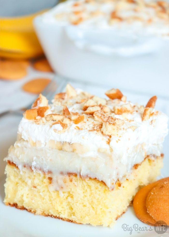 A slice of Banana Cream Pie Poke Cake on a white plate