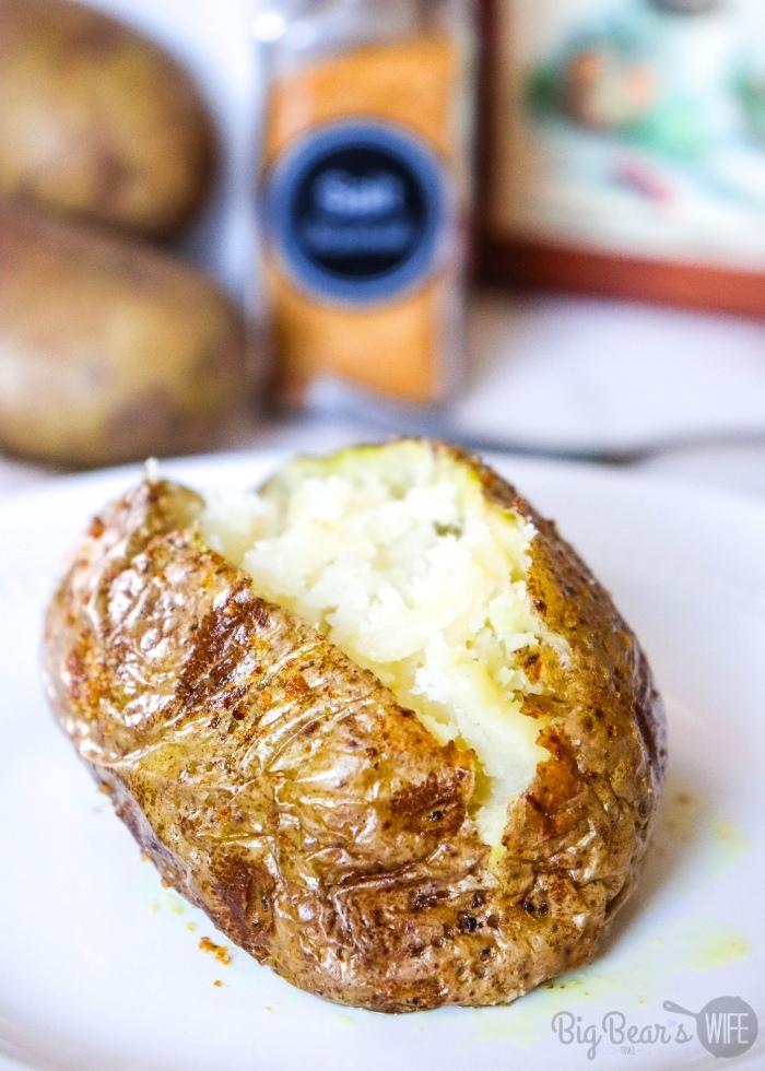 Baked Potato Cut open on white plate